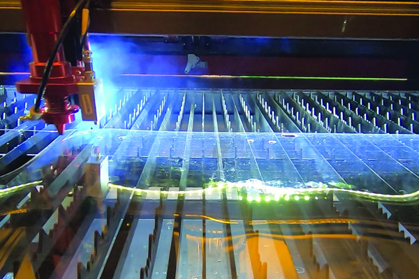 A photo shows items being created with a LASER.