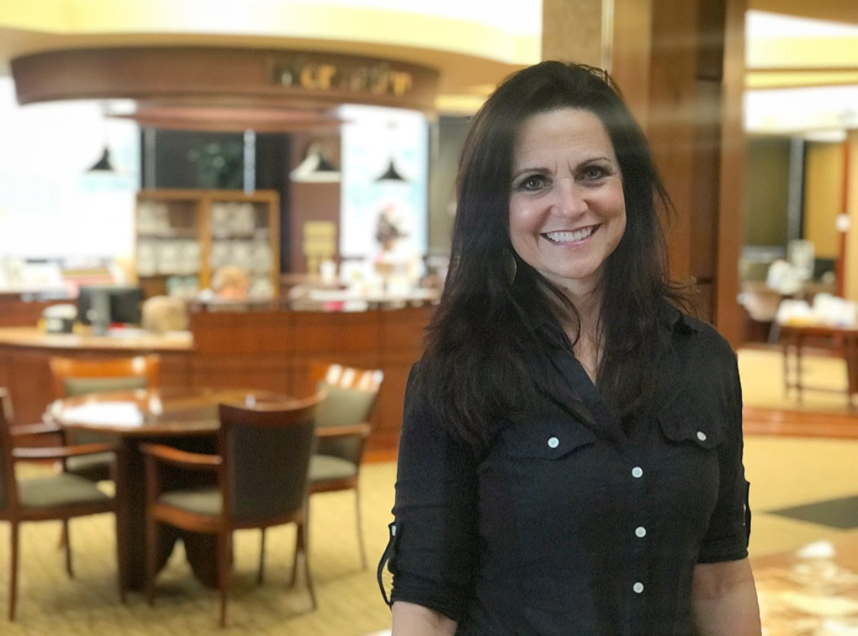 Marla Lucas poses in Hulston Cancer Center's lobby.