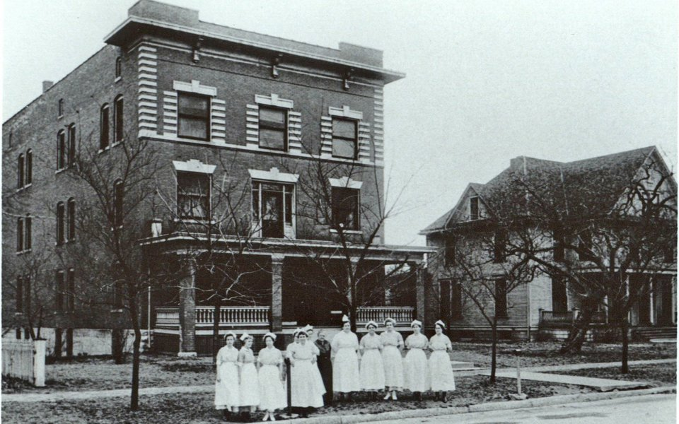 A historic photo of CoxHealth nurses standing outside Burge Deaconess Hospital