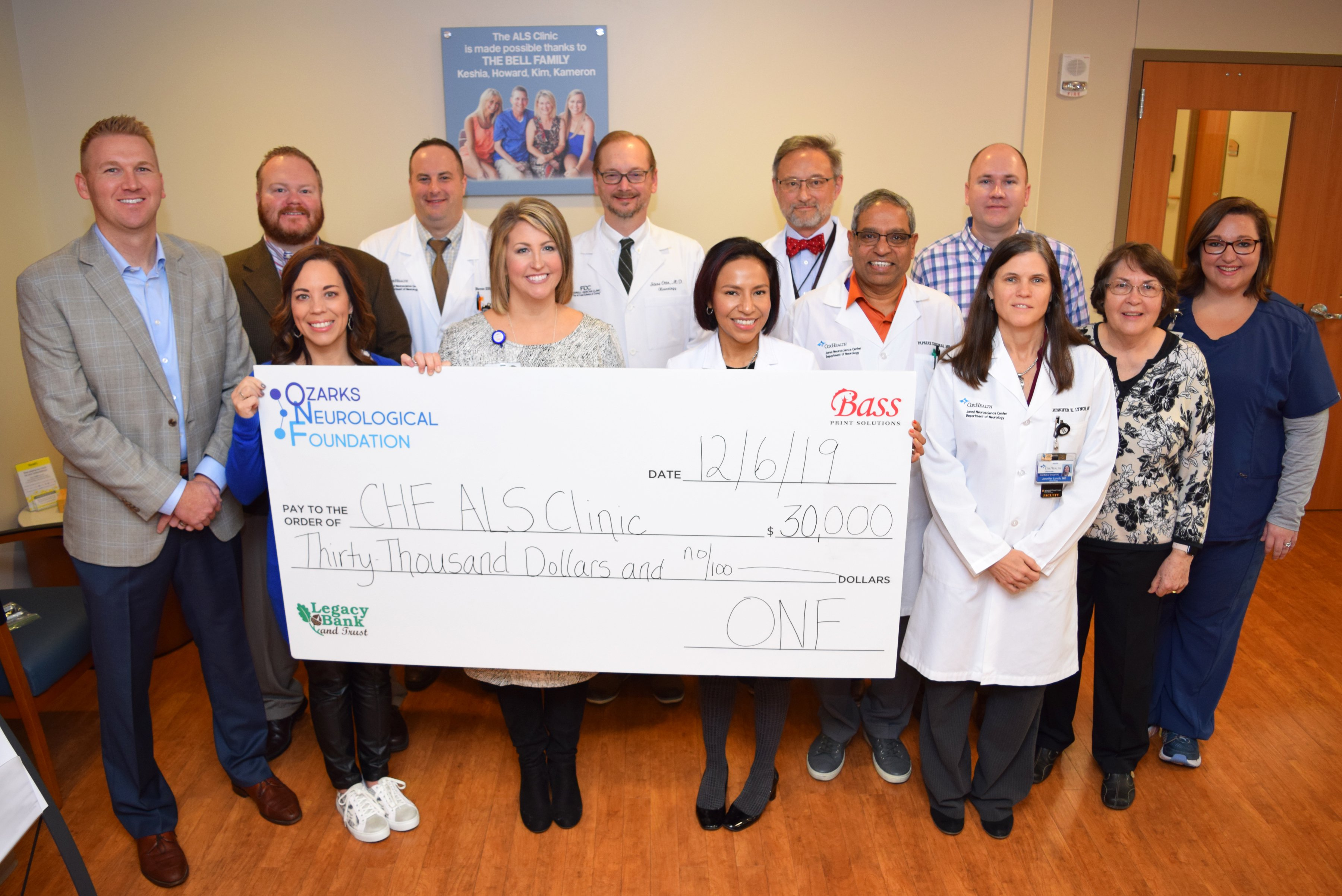 A group of CoxHealth and ONF leaders pose for a photo at the check presentation.