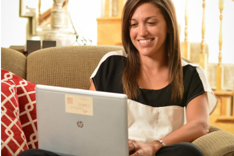 Women using her laptop in a living room