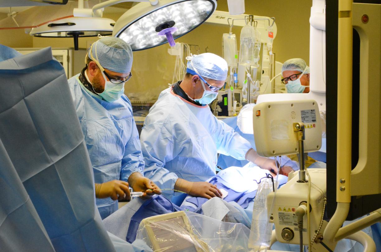 A team does a cardiovascular procedure.