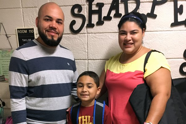 Edwin and Silkia took Noah to his first day of school.