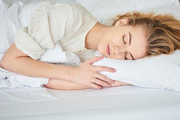 Woman in bed sleeping.