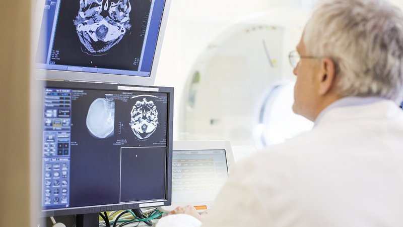 A physician reviews CT scan results at CoxHealth Urgent Care in Springfield Mo.