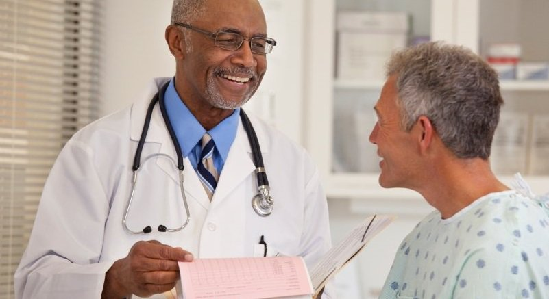 A urologist talks to his patient about test results.