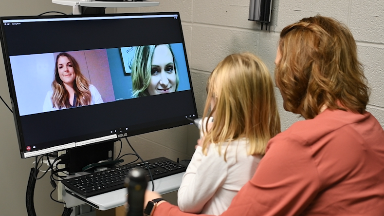 A child receives virtual care.