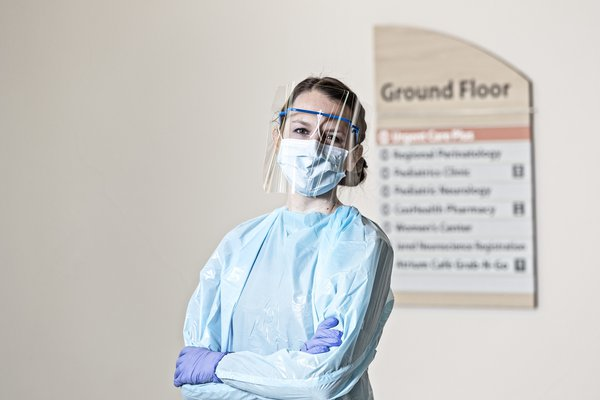 A woman is dressed in PPE.