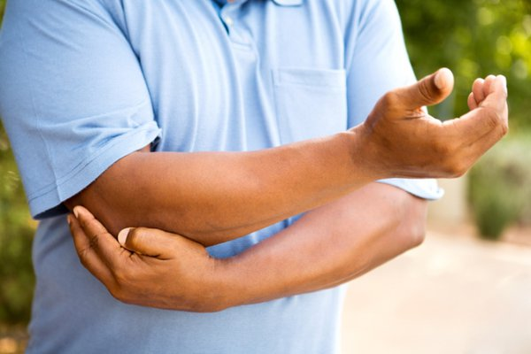 Man pointing to his hurt elbow