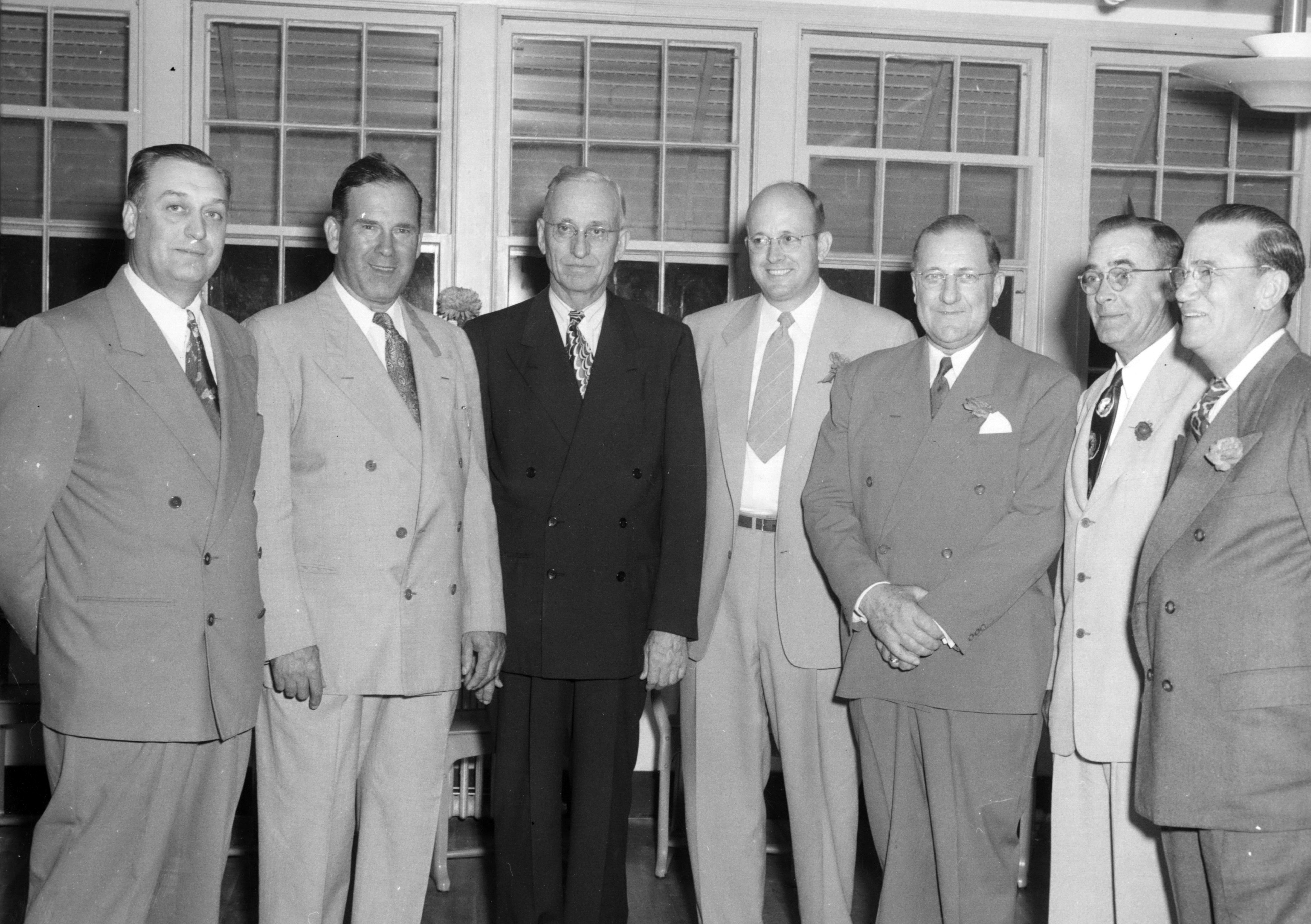 A vintage image of CoxHealth leaders including Lester E. Cox.