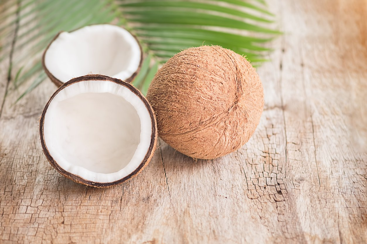 Coconuts sit on a table.