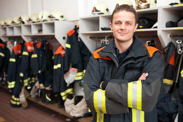 Fire fighter standing in front of their gear
