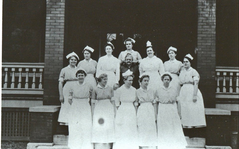 A historic photo of CoxHealth Nurses and Mrs. Burge
