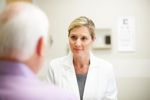 A provider speaks with a patient.