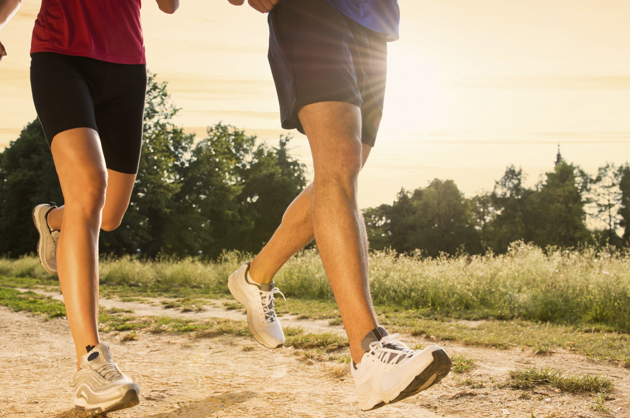 Two runners move down a trail.