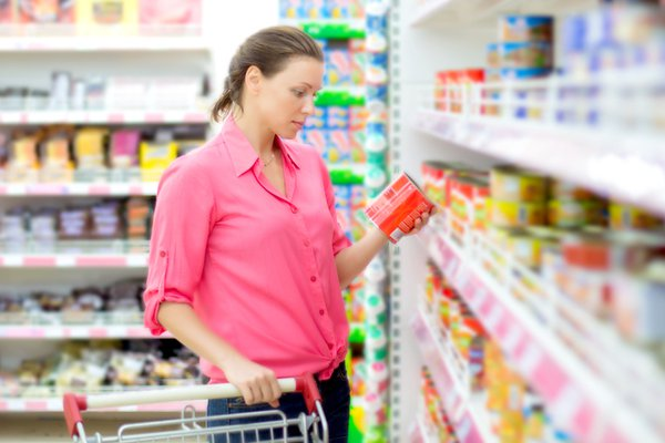 A woman shops for food at a grocery store.